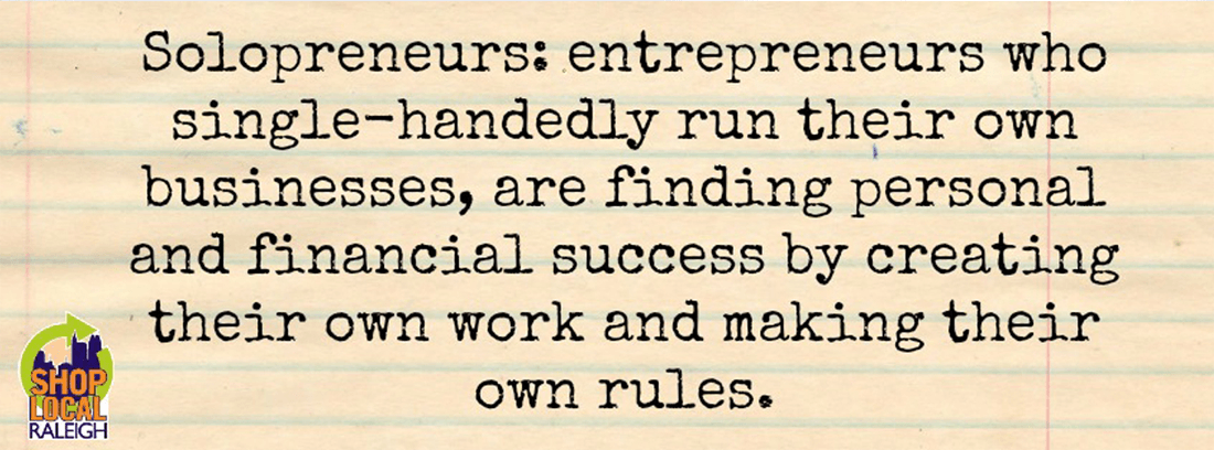 Definition of solopreneurs written in black text on top of aged loose-leaf with the Shop Local Raleigh logo in the bottom left corner.